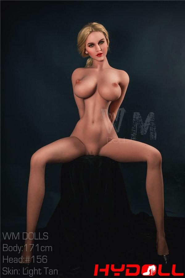 Blonde busty female doll