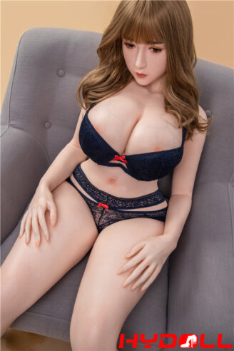 Sex doll sitting on the sofa